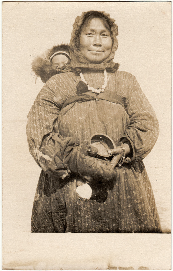 For sale: real photo postcard of an               Eskimo woman with chin tattoos, and her child.