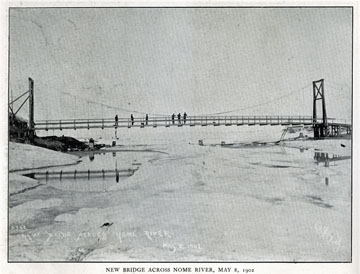 """New bridge across the Nome River, May 8, 1902. For               sale: original view book """"Souvenir of North Western               Alaska"""" by O.D. Goetz."""