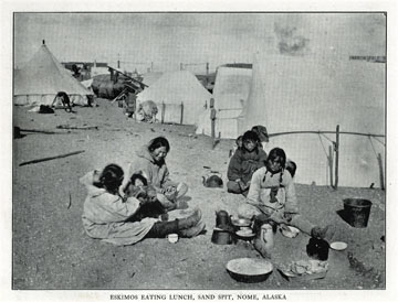 "Eskimos eating lunch, sand spit, Nome, Alaska. For               sale: original view book ""Souvenir of North Western               Alaska"" by O.D. Goetz."