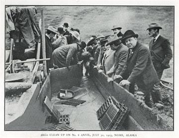 "$8,000 clean up on No. 8 Anvil, July 30, 1903, Nome,               Alaska. For sale: original view book ""Souvenir of               North Western Alaska"" by O.D. Goetz."
