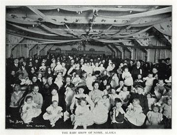"""The baby show of, Nome, Alaska. For sale: original               view book """"Souvenir of North Western Alaska"""" by               O.D. Goetz."""