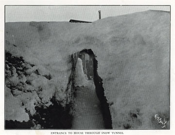 """Entrance to house through snow tunnel. For sale:               original view book """"Souvenir of North Western               Alaska"""" by O.D. Goetz."""