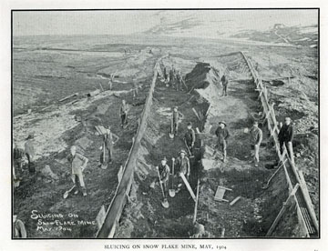 """Sluicing on Snow Flake Mine, May 1904. For sale:               original view book """"Souvenir of North Western               Alaska"""" by O.D. Goetz."""